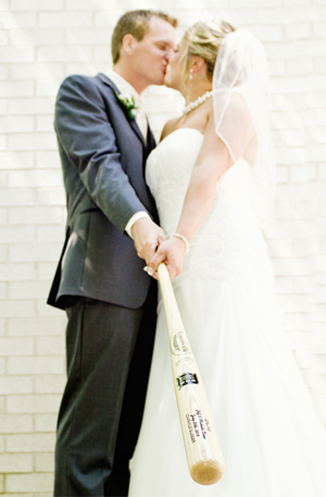 Bride and Groom with their Louisville Slugger Bat